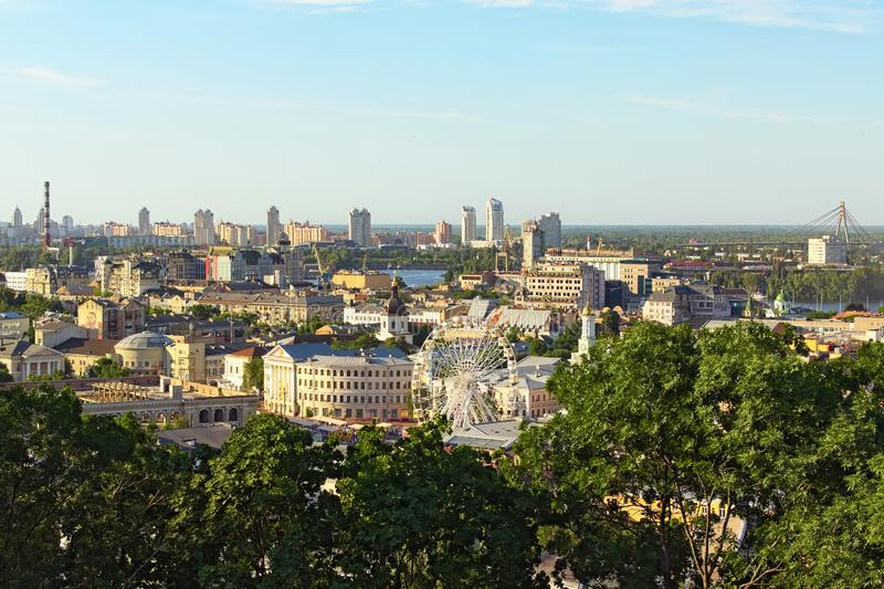 Stunning aerial landscape of Podil neighborhood with skyscrapers in obolon neighborhood on the background royalty free stock photo