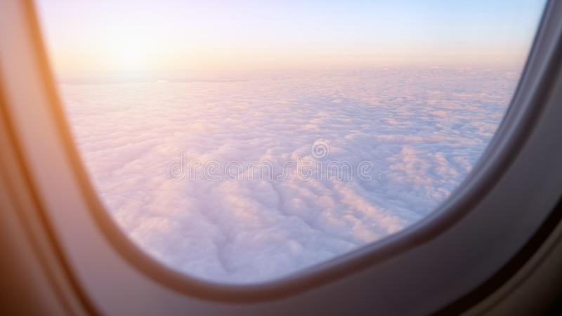 Stunning aerial view above clouds from airplane window. royalty free stock image