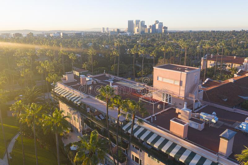 Stunning aerial view of Beverly Hills neighborhood, Beverly Hills Hotel, and Sunset Boulevard surrounded with palm trees royalty free stock photo
