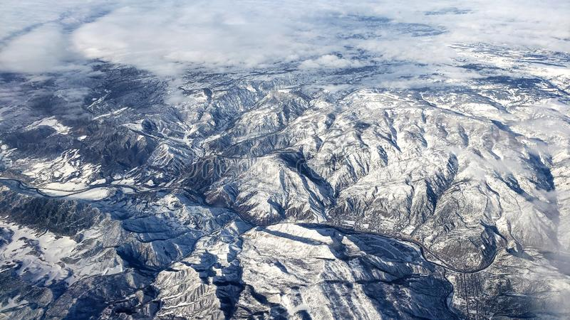 Stunning aerial view of snowy mighty mountains in Colorado. Stunning aerial view of snowy mighty mountains in Colorado, USA royalty free stock image