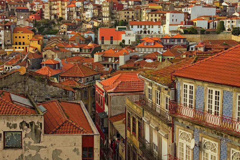 Stunning aerial view of traditional historic buildings in Porto. Vintage houses with red tile roofs. stock photos