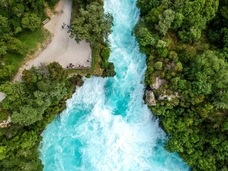 Stunning aerial wide angle drone view of Huka Falls waterfall in Wairakei near Lake Taupo in New Zealand royalty free stock images