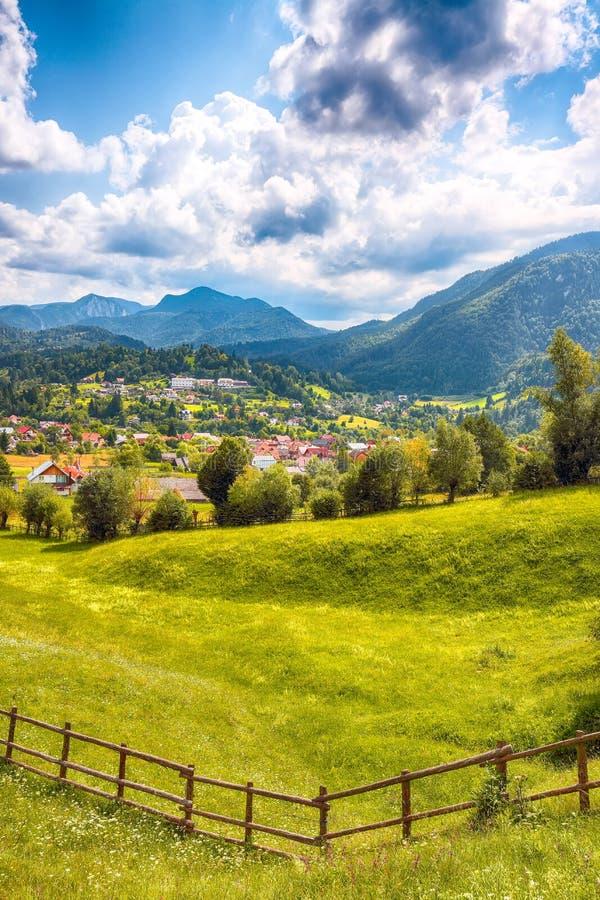 Stunning alpine landscape with green fields and Piatra Craiului mountains in Dambovicioara Commune. Location: Podu Dambovitei village, Arges County royalty free stock photos