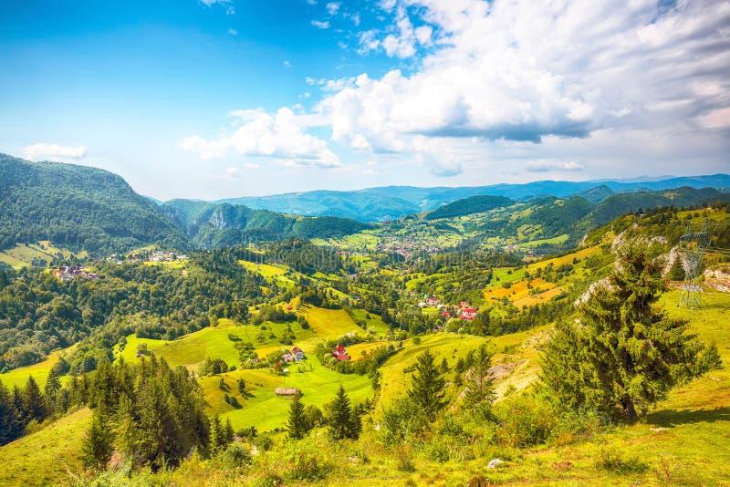 Stunning alpine landscape with green fields and Piatra Craiului mountains in Dambovicioara Commune. Location: Podu Dambovitei village, Arges County stock image