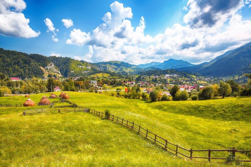 Stunning alpine landscape with green fields and Piatra Craiului mountains in Dambovicioara Commune. Location: Podu Dambovitei village, Arges County stock photos