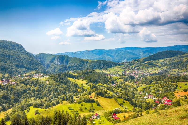 Stunning alpine landscape with green fields and Piatra Craiului mountains in Dambovicioara Commune. Location: Podu Dambovitei village, Arges County stock images