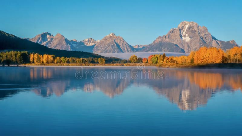 A stunning autumn landscape in Grand Teton National Park, Wyoming. stock photos