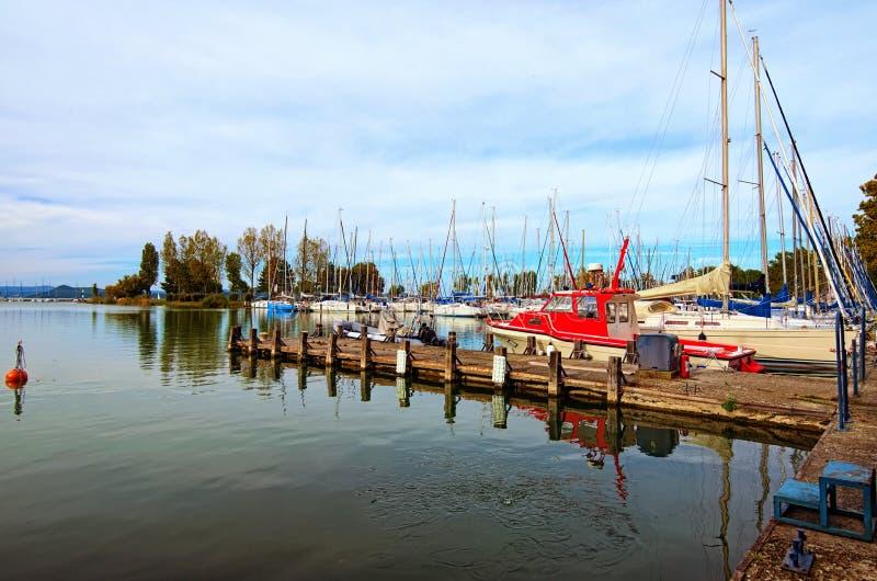 Stunning autumn landscape view of sailboats and small yachts anchored in Balatonfoldvar at Lake Balaton, Hungary. royalty free stock photography