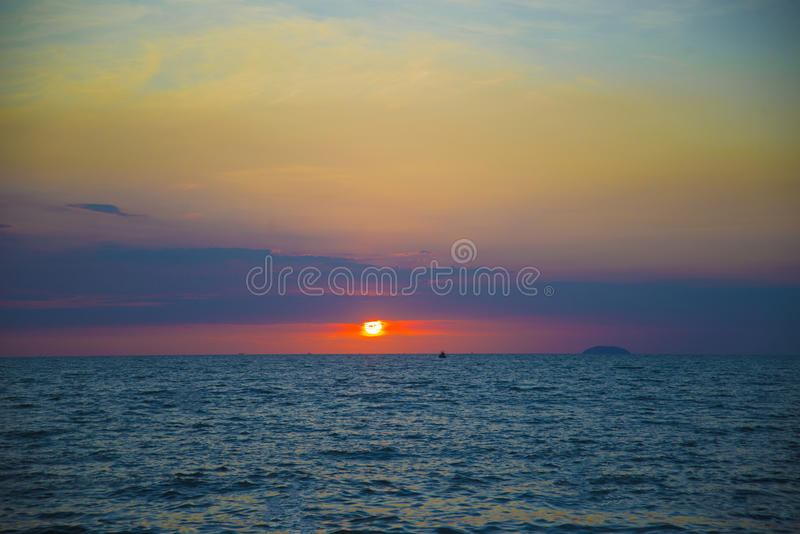 Stunning beautiful sunset in the Gulf of Thailand. Dark sky painted with bright colors stock photos