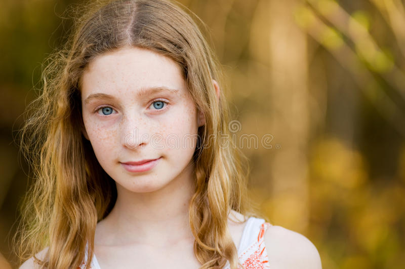 Stunning blue eyes. Close up of teen girl with stunning blue eyes looking at the camera stock images