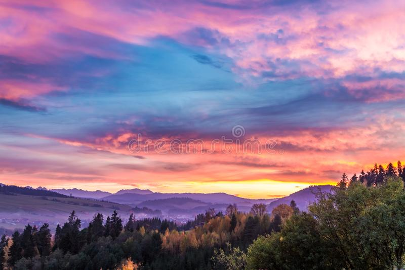 Stunning castle by the lake at sunset in autumn. Europe royalty free stock photos