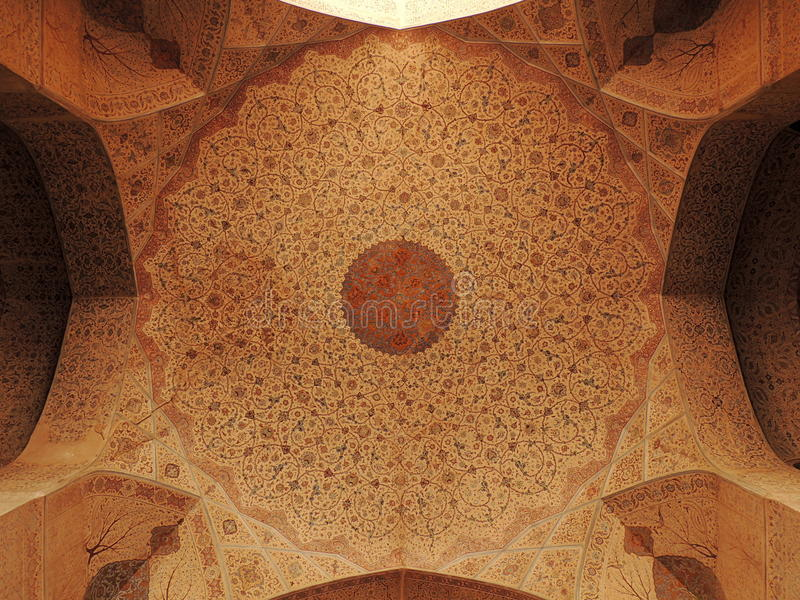 Stunning ceiling decorations at the Ali Qappu palace in Isfahan. Complete decorations of the first floor ceiling of the Ali Qappu palace in Isfahan, headquarters royalty free stock photo