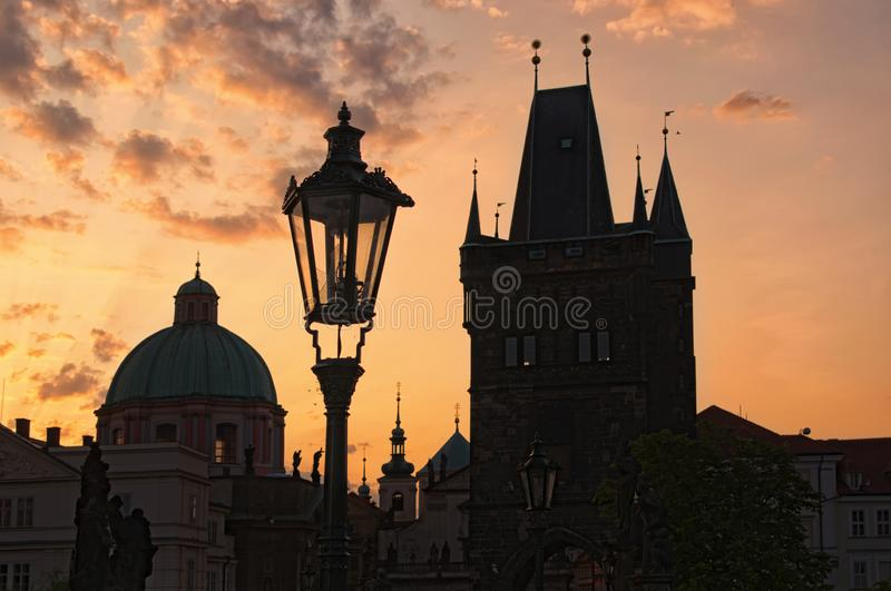 Stunning cityscape of Charles Bridge during sunrise. Statues on Charles Bridge, lanterns and Old Town Bridge Tower. stock image