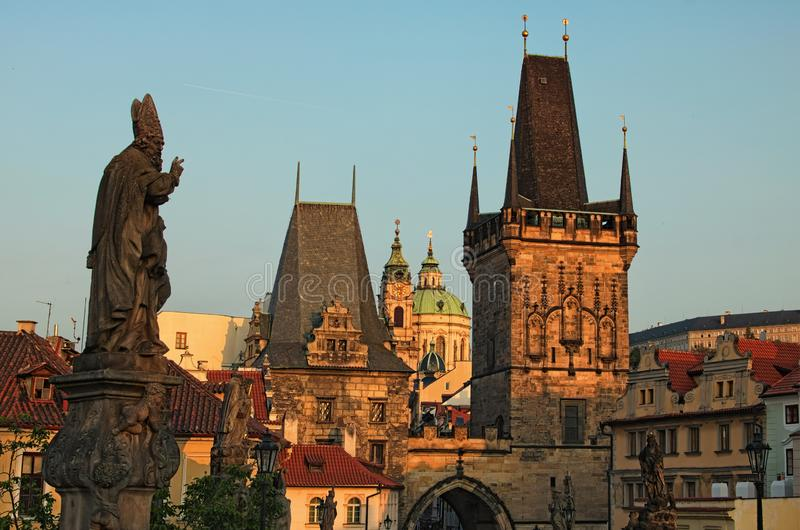 Stunning cityscape of Charles Bridge during sunrise. Statues on Charles Bridge, lanterns and Old Town Bridge Tower royalty free stock photos