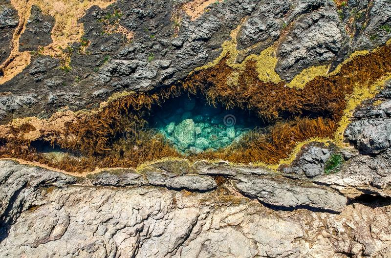 Stunning close up aerial drone view of a rock pool at the Mermaid Rock Pools at Matapouri Bay near Whangarei on the North Island royalty free stock image