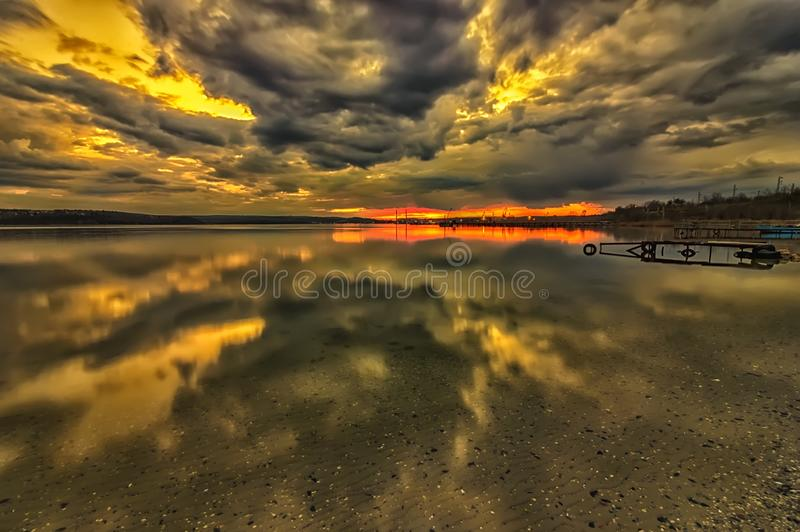 Stunning clouds with transparent water reflection royalty free stock photography