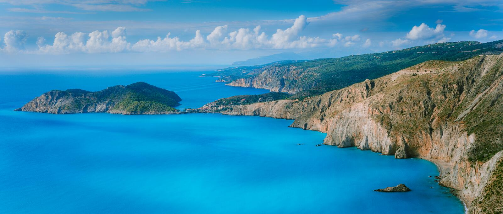 Stunning coastal panorama and beautiful clouds at the horizon on Kefalonia island. Mediterranean Sea summer coastal stock images