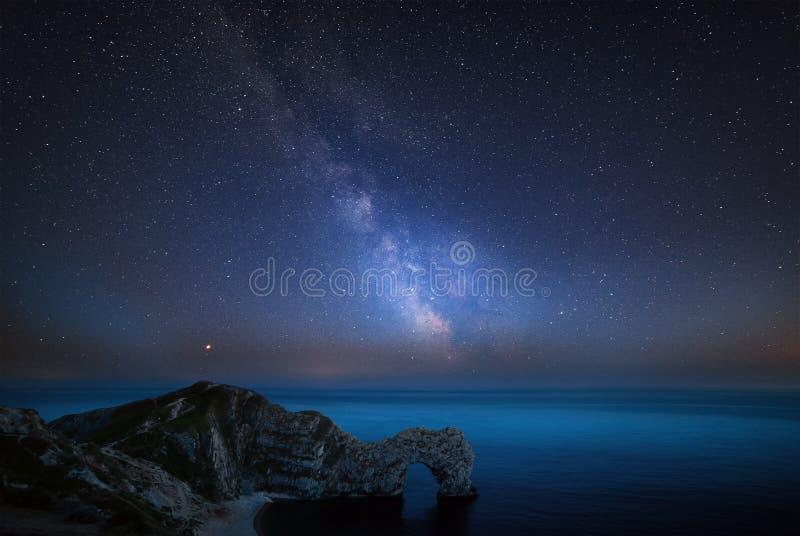 Beautiful vibrant image of Milky Way galaxy over sea landscape i stock photo