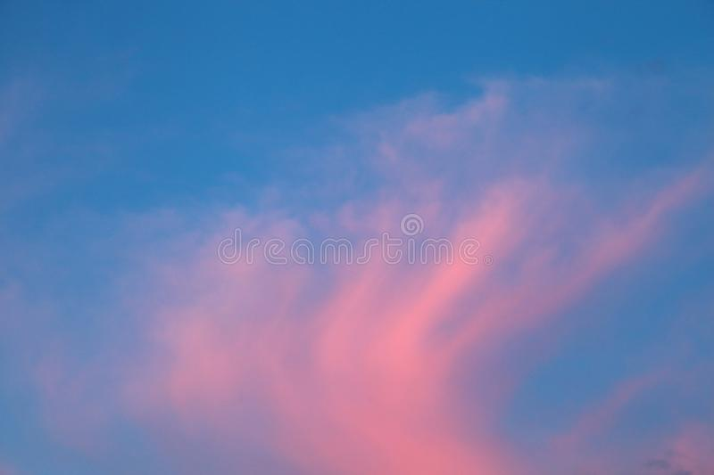 Stunning colorful twilight sky at sunrise with bright vibrant pink cloud royalty free stock photo