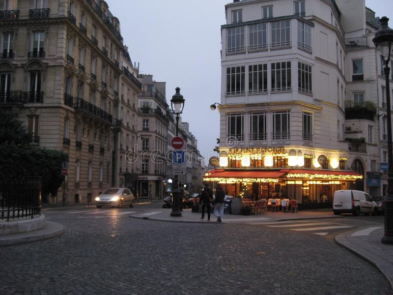 A stunning corner restaurant on an evening in Paris.  royalty free stock photography