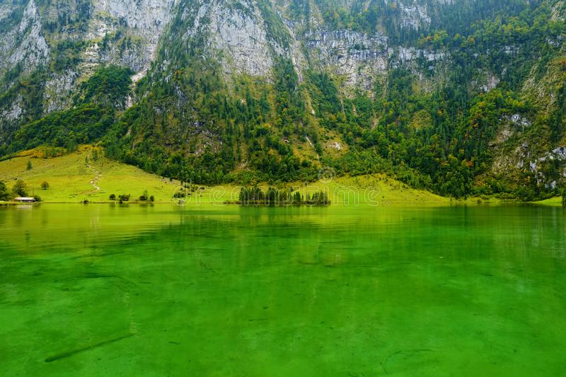 Stunning deep green waters of Konigssee, known as Germany`s deepest and cleanest lake, located in the extreme southeast Berchtesg stock image