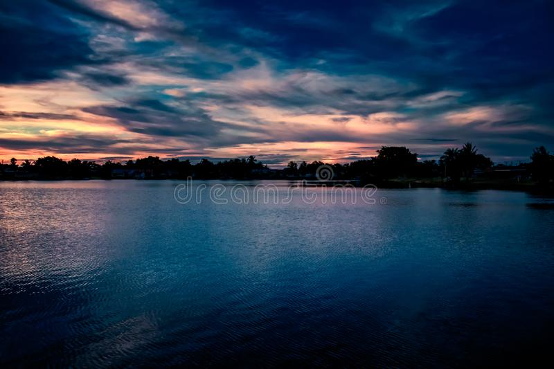 Stunning, dramatic sky sunset landscape in Sunrise, South Florida. Lake at sunset royalty free stock photography