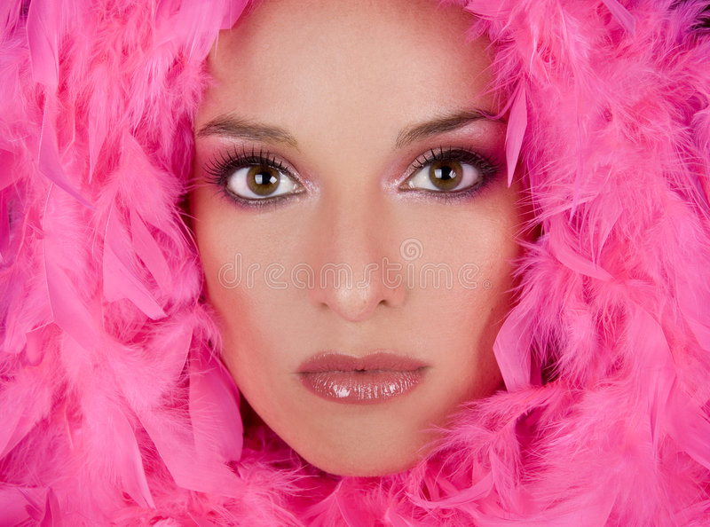 Stunning face. Pretty model with bright makeup wearing pink boa royalty free stock photos