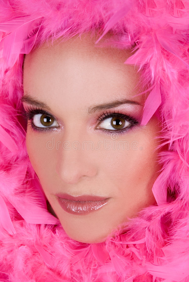 Stunning face. Pretty model with bright makeup wearing pink boa royalty free stock images