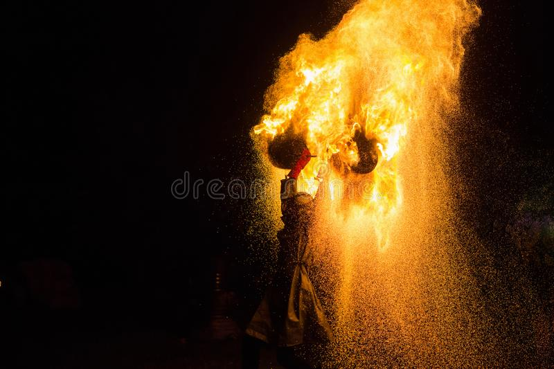 A stunning fire show against a dark night. stock photography