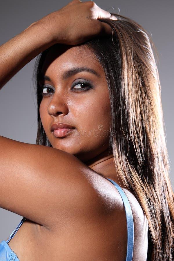 Stunning headshot of beautiful young exotic girl stock images