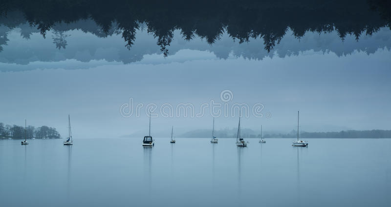 Stunning impossible puzzling conceptual landscape image of lake stock photos
