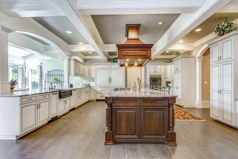 Stunning kitchen room design with large bar style island. Stunning kitchen room design with large bar style island and coffered ceiling stock image
