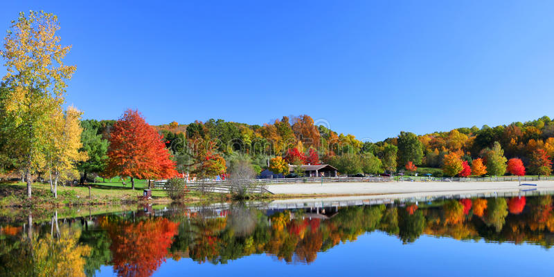 Stunning lake in fall. Stunning New England lake in fall with blue sky stock images