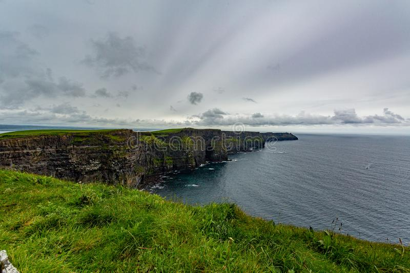 Stunning landscape of the Cliffs of Moher. Geosites and geopark, Wild Atlantic Way, wonderful cloudy spring day in the countryside in County Clare in Ireland stock photography