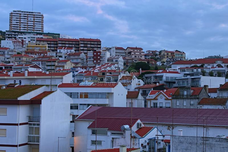 Stunning landscape view of vintage buildings with red tile roofs in the Portuguese resort of Nazare. Cloudy morning. Popular travel destination in Portugal royalty free stock photography