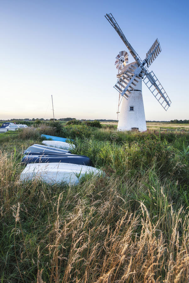 Stunning landscape of windmill and river at dawn on Summer morni stock image