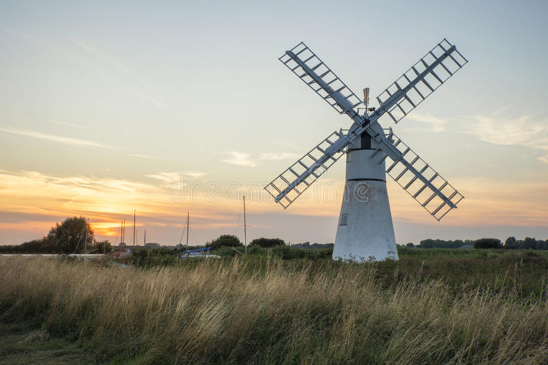 Stunning landscape of windmill and river at dawn on Summer morni royalty free stock images