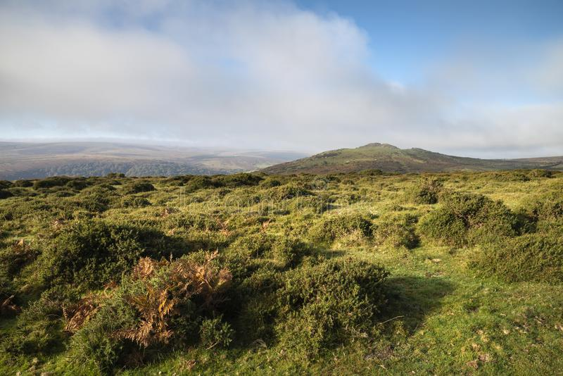 Stunning lansdcape view across Dartmoor during misty Autumnal mo. Beautiful lansdcape view across Dartmoor during misty Autumnal morning royalty free stock photos