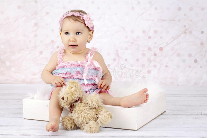 Stunning little baby girl with teddy bear stock image