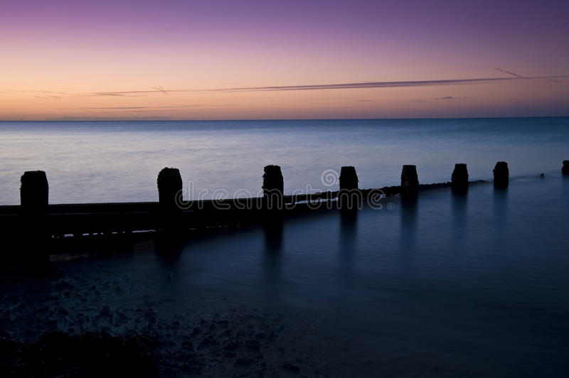 Download Stunning Long Exposure Sunrise Over Calm Sea Stock Photo - Image: 20776756