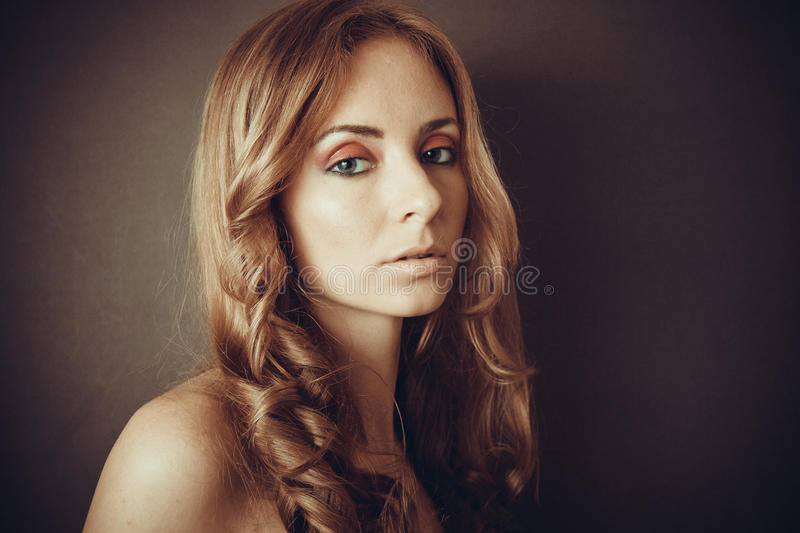 Stunning look and curly hair stock photos