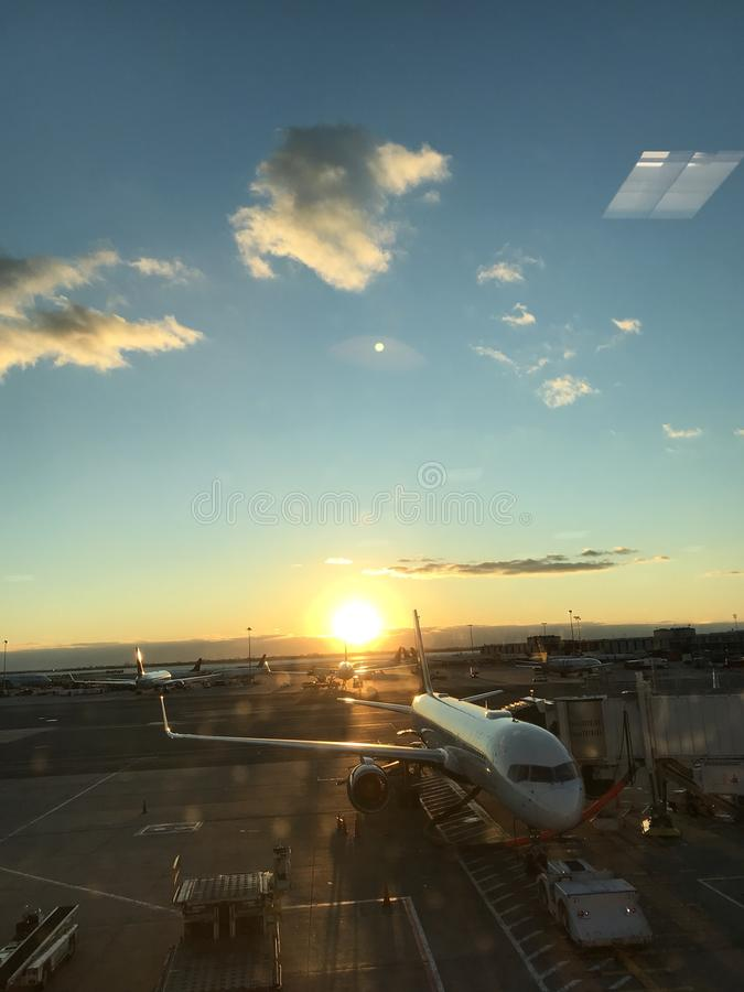 A stunning look outside of a airplane and onto a sunny ocean royalty free stock photo