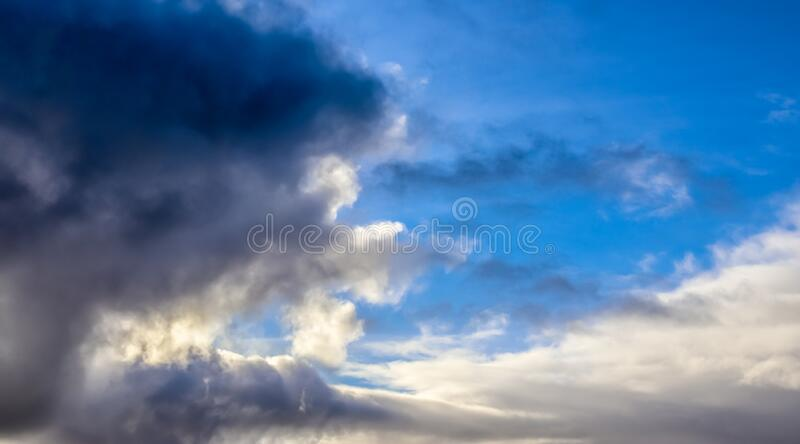 Stunning mixed cloud formations on a deep blue summer sky. Found over Germany royalty free stock photography
