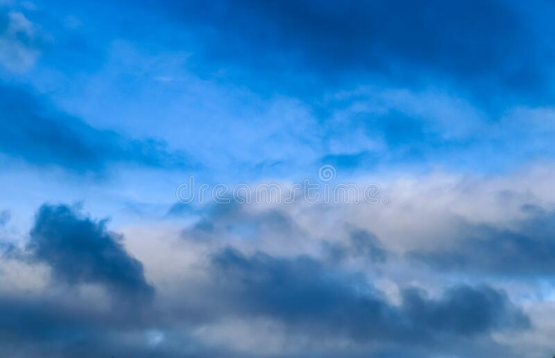 Stunning mixed cloud formations on a deep blue summer sky. Found over Germany stock photography