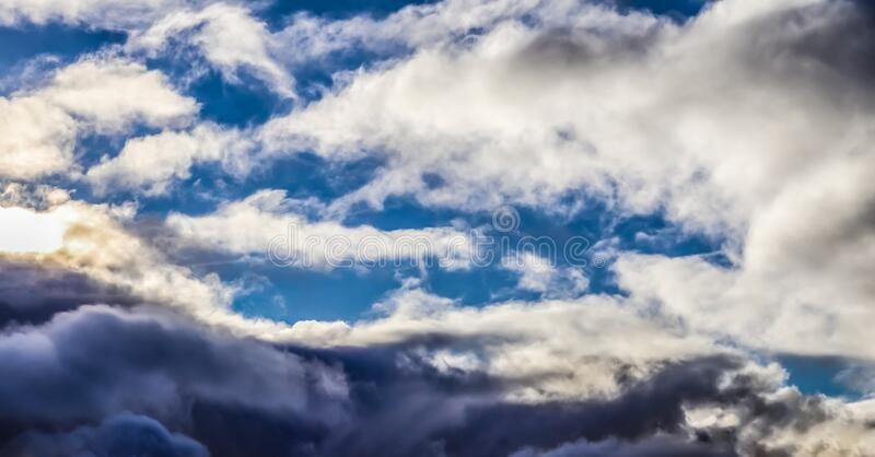 Stunning mixed cloud formations on a deep blue summer sky. Found over Germany royalty free stock photos