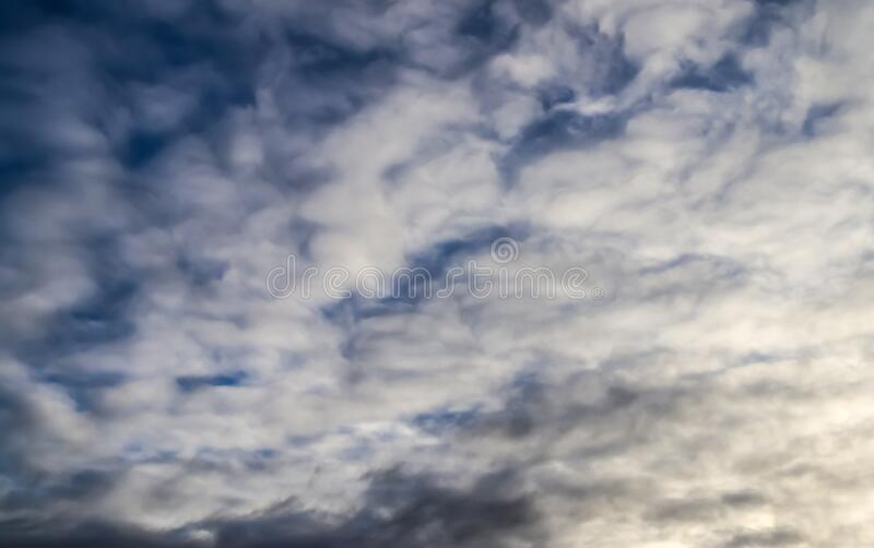 Stunning mixed cloud formations on a deep blue summer sky. Found over Germany stock photo
