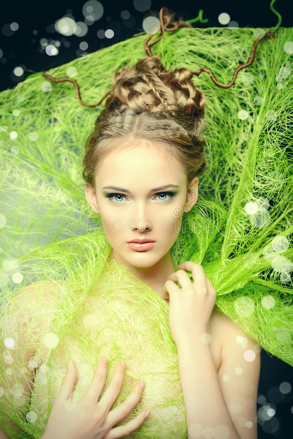 Stunning model. Fashion shot of a stunning female model with beautiful hairstyle. Spring beauty stock photo