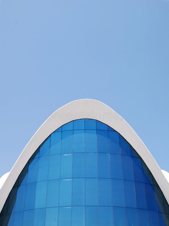 Stunning Modern Architecture 5. Building under a blue sky with beautiful lines and curves. Abstract wave stock image