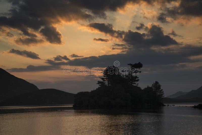 Stunning mountain and lake sunrise reflections beautiful landscape with sunbeams stock photography