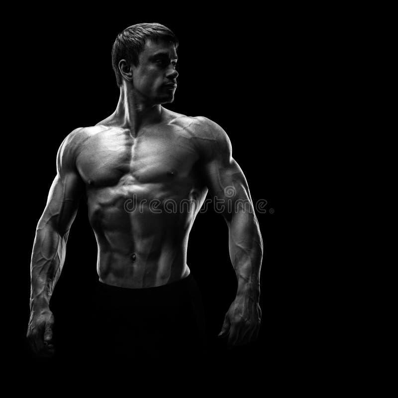Stunning muscular young men bodybuilder looking behind stock photos